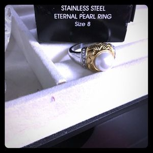 STAINLESS  STEEL ETERNAL PEARL RING.